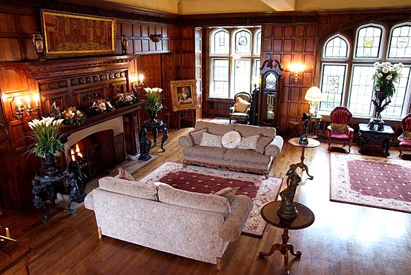 A tudor style living room with a large central fireplace